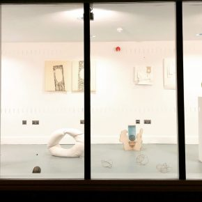 Street view into an exhibition of work by course tutors; floor, plinth and wall-based work