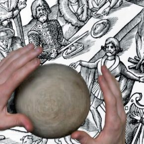 View down onto two hands working with a ball of clay on top of a historic black and white illustration.